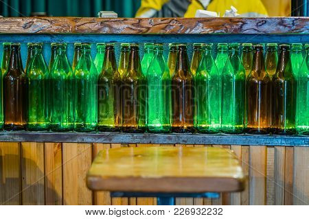 Bar Counter. Decorated With A Niche With A Set Of Empty Bottles. Designer Internal Solution. Glass B