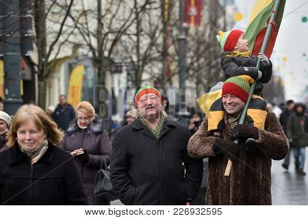 Vilnius, Lithuania - February 16: Unidentified People Gathered With Flags In A Natonal Celebration F