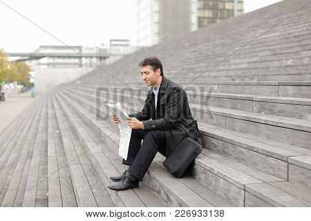 Effect. Tutor Dressed In Gray Coat Sitting On Rung And Read Morning Newspaper. Articles Pleased Man