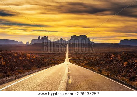 Desert Road Leading To Monument Valley Photographed At The Forrest Gump Point With Dramatic Sunset S