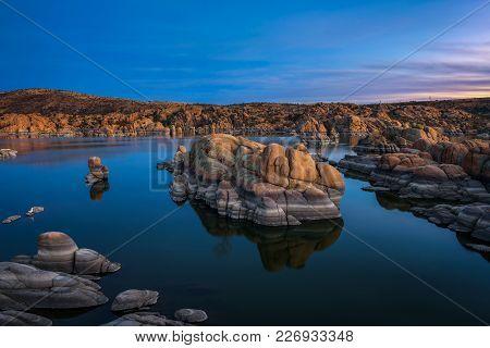 Sunset Above Watson Lake In The Granite Dells Of Prescott, Arizona. Long Exposure.