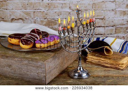 Jewish Holiday Hanukkah Celebration With Vintage Menorah And Donuts