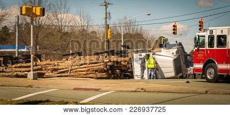 Fire Truck And Overturned Logging Truck