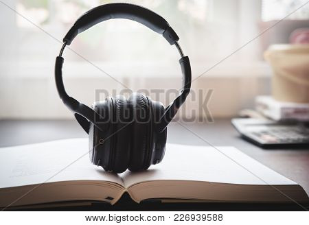Headphones Audiobook Concept. Audio Electronic Devices, Gadgets