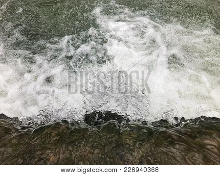 Top Angle View Of Flowing River Water.