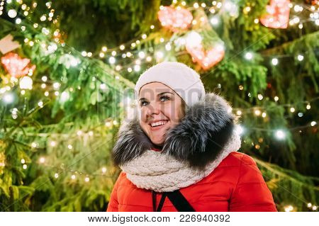 Tallinn, Estonia. Young Beautiful Pretty Caucasian Girl Woman Dressed In Red Jacket And White Hat En