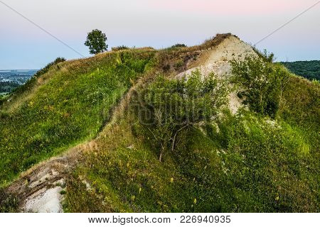 Ancient Cretaceous Overgrown High Hill With Outcrops Of Chalk. Territory Natural Archaeological Monu