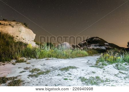 Starry Night Sky Over The White Cretaceous Hills. Night Natural Landscape With Chalk Path Trail. Nat