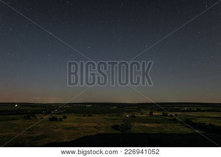 View Of Green Forest-steppe Plain At Night. Landscape From Height With Starry Sky Over The Horizon.