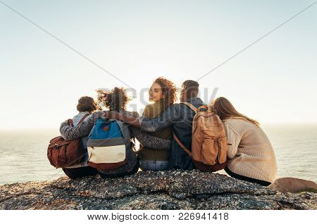 Woman With Friends Enjoying A Day Outdoors