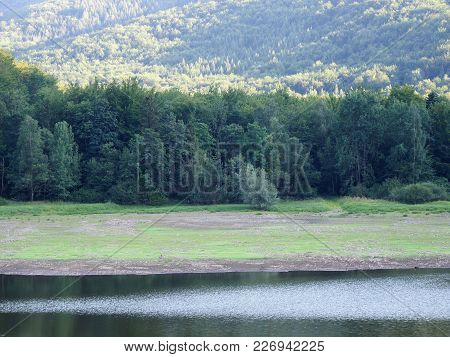 Green Forest And Water Reflection On Lake At Desolate Beskid Mountains Range Landscapes Near City Of