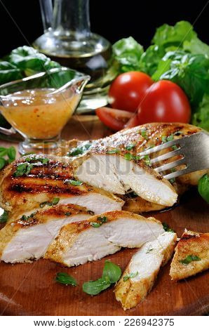 Sliced Juicy, Tender Chicken Breast Grill With Vegetable Ingredients And Dressing For A Warm Salad