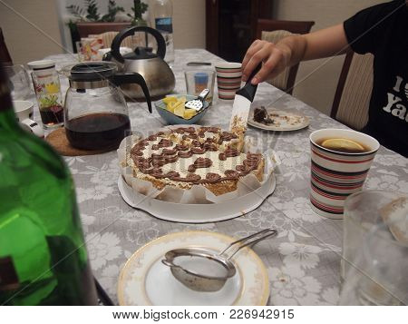 Cutting Cake At Home. Clutter On The Table. Brewed Tea In A Teapot, Chopped Lemons.