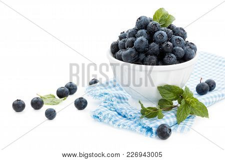 Fresh Blueberries And Mint. With Waterdrops. Isolated On White Background.
