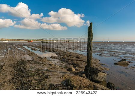 A Wooden Post With Some Clouds, Seen At The Oare Marshes Near Faversham, Kent, England, Uk - With So