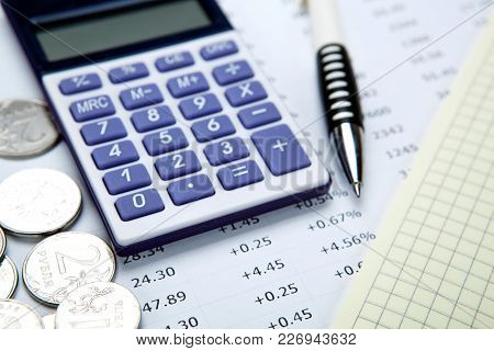 Russian Rubles With Calculator And A Pen Close Up