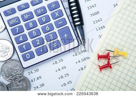 Russian Rubles With Calculator And A Pen And Digits Closeup