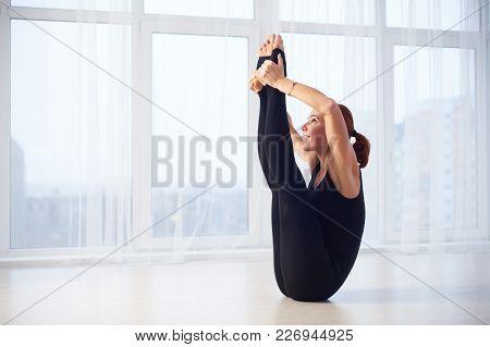 Beautiful Red Head Woman Practices Yoga Asana Eka Pada Padma Urdhva Mukha Paschimottanasana In The Y