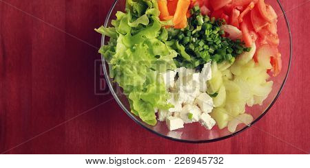 Glass Bowl With Cutted Vegetables For A Salad. Copy Space. Tomatoes, Celery, Bell Pepper, Leafy Gree
