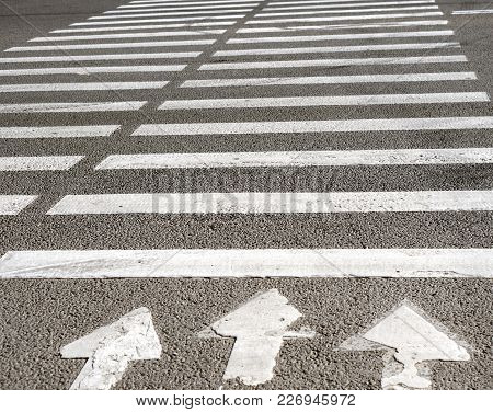 Zebra Road Marking Of The Pedestrian Crossing.