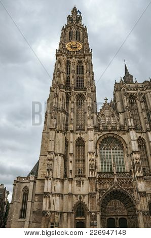 Bell Tower And Gothic Facade Of The Cathedral Of Our Lady In Antwerp. Port And Multicultural Metropo