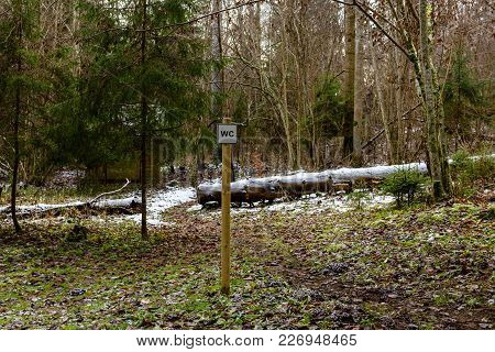 Winter Rural Scene With Road And Sign Showing Direction