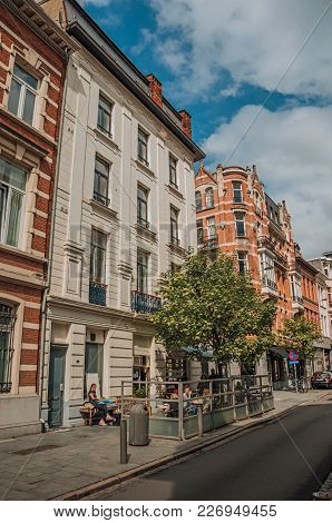 Antwerp, Northern Belgium - July 02, 2017. People And Buildings In A Street Of Antwerp. Port And Mul
