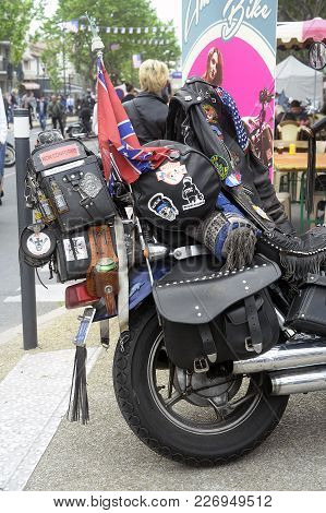 Beaucaire, France - April 30, 2016: A Motorcycle Covered With Travel Memories In A Gathering Of Amer