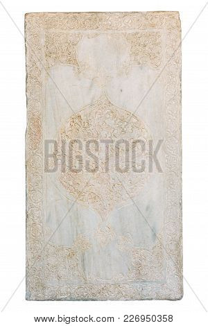 Carved Medieval Arabic Pattern On A Marble Slab Isolated On White