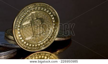 Photo .golden Bitcoins On A Gold Background New Virtual Money