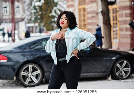 Stylish African American Plus Size Model With Mobile Phone At Hand  At Winter Snowy Day Against Blac