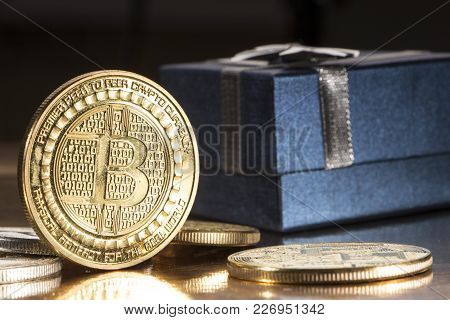 Bitcoin Btc Cryptocurrency And Gift Box Btc Golden Coin As Symbol Of Electronic Virtual.
