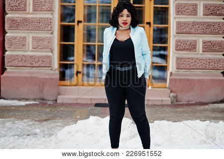 Stylish African American Plus Size Model At Streets Of City On Winter Day.