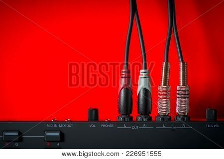 Musical Instrument And Wires On An Intense Red Background