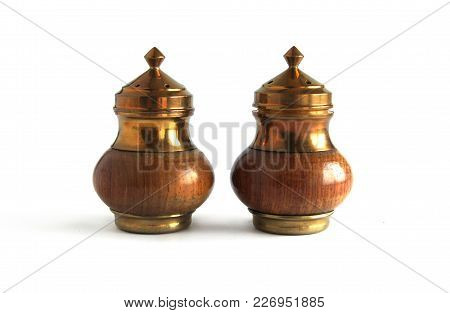 Vintage Wooden And Brass Salt And Pepper Set On White Background