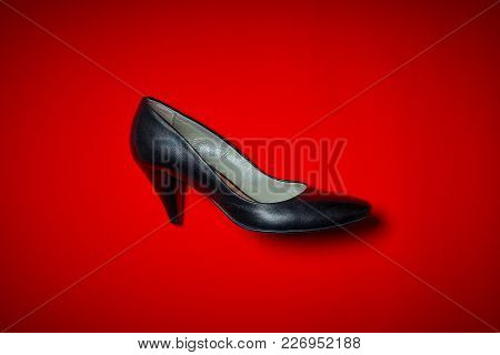 Top View Of Black High Heels On An Intense Red Background