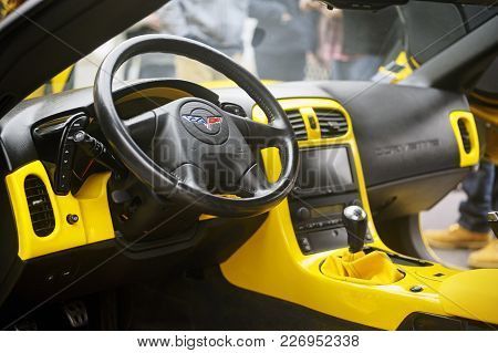 Beaucaire, France - April 30, 2016: A Yellow Corvette Exposed To A Gathering Of American Motorcycles