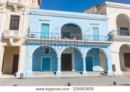 The Old Square Or Plaza Vieja And The Porch Of The Fototeca De Cuba, Old Havana, Cuba.