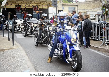Beaucaire, France - April 30, 2016: Motorcyclists Driving On The Street In A Gathering Of American M