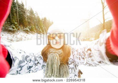 Beautiful Young Woman Taking A Selfie In Winter Nature. Pretty Woman Taking A Photo In A Nature. Win