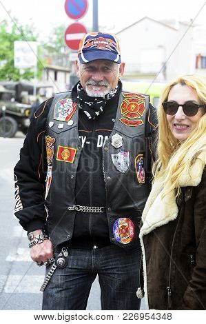 Beaucaire, France - April 30, 2016: Biker With A Jacket Full Of Badges And Embroidery In A Gathering