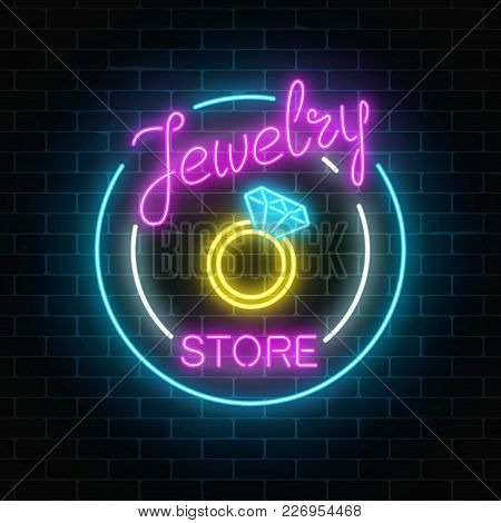 Jewelry Store Glowing Neon Signboard On Dark Brick Wall Background. A Ring With Big Diamond. Bijou S