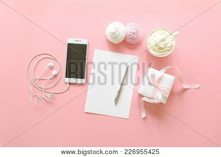 Feminine Desk Workspace In White And Pink Colors With Cream Coffee Cup, Meringues, Gift Box, White C