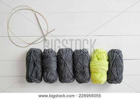 Yarn For Knitting With Circular Spokes On White Wooden Background. The Concept Of Hobbies, Crafts, T