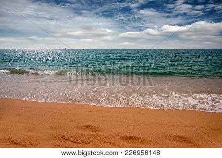 coast of the Mediterranean Sea and a beautiful cloudy sky