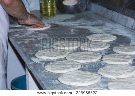 Baked Bread In The Wood-burning Oven. Typical Sicilian Tradition. Traditional Fresh Bread In Sicily.