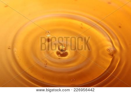 a drop of strong alcohol falls into the glass