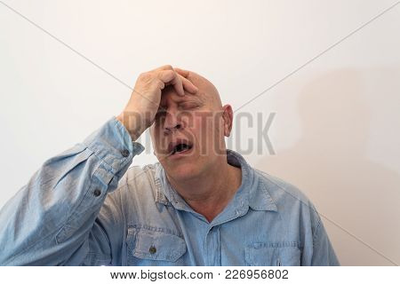 Older Man Hand To Forehead In Distress Or Pain, Bald, Alopecia, Chemotherapy, Cancer, Isolated On Wh