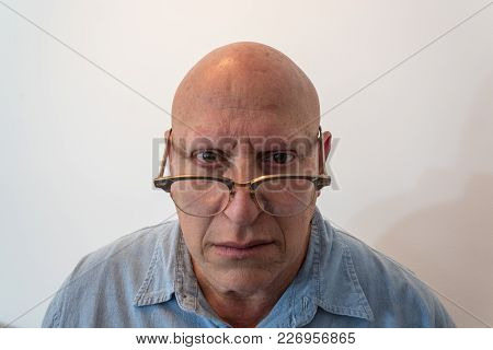 Older Man Looking Over Horn Rimmed Glasses, Bald, Alopecia, Chemotherapy, Cancer, Isolated On White,