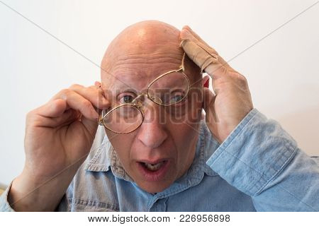 Older Man With Glasses Cocked, Bald, Alopecia, Chemotherapy, Cancer, Isolated On White, Vertical Asp